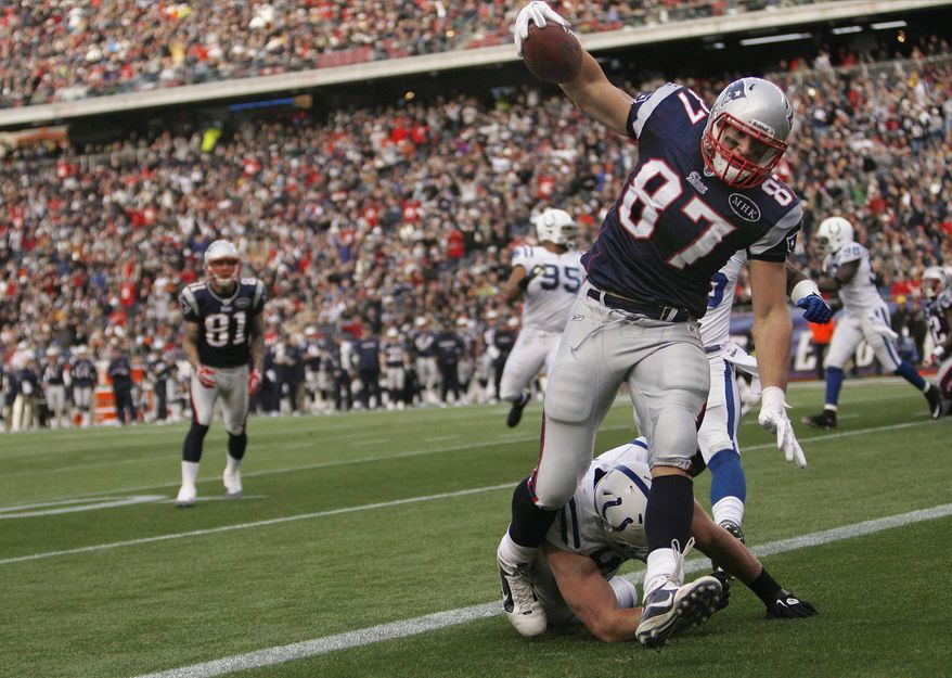 New England Patriots tight end Rob Gronkowski has 65 receptions for 928 yards and 13 touchdowns this season. Fellow tight end, Aaron Hernandez, has 54 catches, 523 yards and five scores for New England. The two will oppose the Washington Redskins on Sunday. (AP Photo/Charles Krupa)