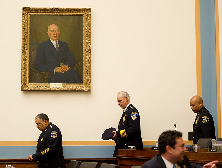 "Philadelphia Police Department Police Commissioner Charles Ramsey, left, Baltimore Police Department Commissioner Frederick H. Bealefeld III, center, and Detroit Police Chief Ralph Godbee, right, enter the House Judiciary Committee room to show support for U.S. Attorney General Eric Holder as he testifies about ""Fast and Furious"" a federal gun sting which allowed weapons to go to Mexican drug cartels through straw buyers, Thursday, December 8, 2011. (Andrew Harnik / The Washington Times)"