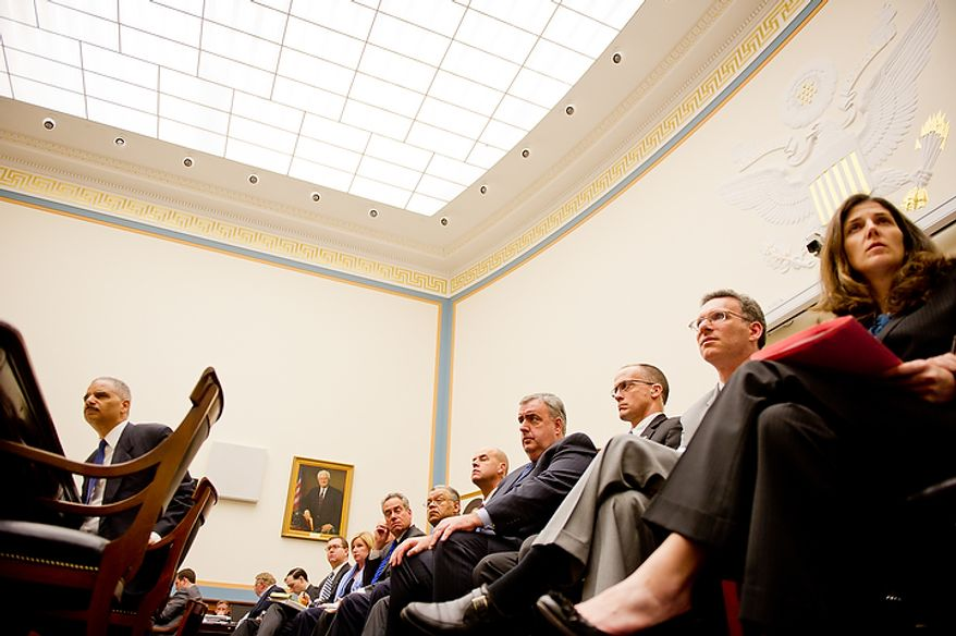 "U.S. Attorney General Eric Holder, left, appears before the House Judiciary Committee to answer questions about ""Fast and Furious"" a federal gun sting which allowed weapons to go to Mexican drug cartels through straw buyers, Thursday, December 8, 2011. (Andrew Harnik / The Washington Times)"