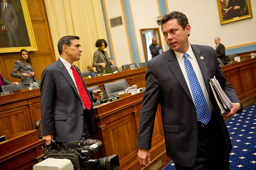"""Congressman Darrell Issa (R-Calif.), left, and Congressman Jason Chaffetz (R-Utah), right, depart after questioning U.S. Attorney General Eric Holder while he appears before the House Judiciary Committee to answer questions about """"Fast and Furious"""" a federal gun sting which allowed weapons to go to Mexican drug cartels through straw buyers, Thursday, December 8, 2011. (Andrew Harnik / The Washington Times)"""