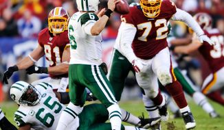 Washington Redskins linebacker Ryan Kerrigan and defensive lineman Stephen Bowen bear down on New York Jets quarterback Mark Sanchez as he drops back to pass Sunday, Dec. 4, 2011, in Landover, Md. The Jets won 34-19. (AP Photo/The Free Lance-Star, Dave Ellis)