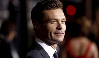 "Ryan Seacrest arrives at the premiere of ""New Year's Eve"" in Los Angeles on Monday, Dec. 5, 2011. (AP Photo/Matt Sayles)"