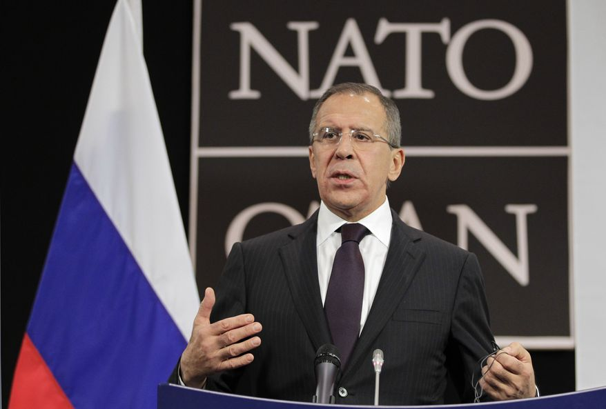 ** FILE ** Russian Foreign Minister Sergei Lavrov holds a press conference during the annual gathering of NATO foreign ministers at the alliance's headquarters in Brussels on Thursday, Dec. 8, 2011. (AP Photo/J. Scott Applewhite, Pool)