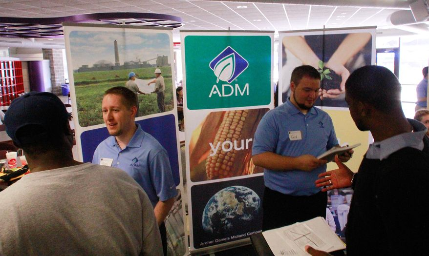 Archer Daniels Midland Co. employees answer questions and hand out job applications during a job fair on the Springfield campus of the University of Illinois on Thursday, Sept. 1, 2001, in Springfield, Ill. (AP Photo/Seth Perlman)