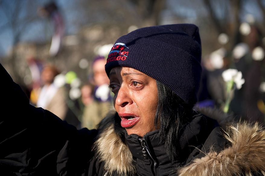 "Hilary Addison of Chicago, Ill., cries during the singing of the song ""We Shall Overcome"" as she joins people from organizations from across the United States such as the Service Employees International Union (SEIU) at Upper Senate Park in Washington, D.C., Thursday, December 8, 2011, for an Interfaith Service for the Jobless, with unemployed workers and faith leaders. They are calling on Congress not to cut jobs and for the extension of unemployment insurance, which is set to expire at the end of the year unless Congress takes action. (Rod Lamkey Jr./The Washington Times)"