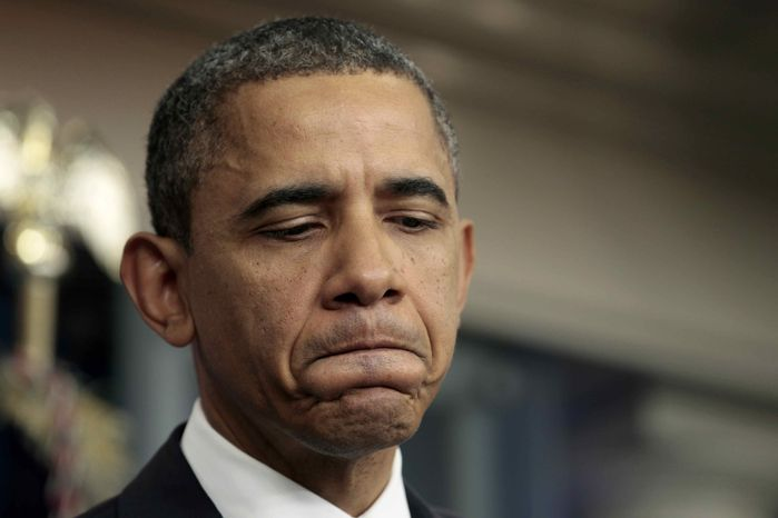 ** FILE ** President Barack Obama pauses during a news conference, Thursday, Dec. 8, 2011, in the White House briefing room in Washington. (AP Photo/Carolyn Kaster)