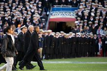 President Barack Obama and Vice President Joe Biden walk out to center field to do the coin flip before the Army-Navy game at Fedex Field, Landover, MD, Saturday, December 10, 2011. (Andrew Harnik / The Washington Times)