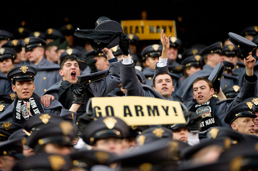 Army Cadets cheer as Army scores their first touchdown of the game to bring the score to 7-14 in the second quarter of the Army-Navy game at Fedex Field, Landover, MD, Saturday, December 10, 2011. (Andrew Harnik / The Washington Times)