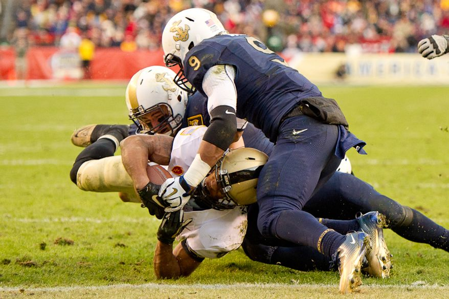 Army Black Knights running back Malcolm Brown (23) ties the game 14-14 just before halftime of the Army-Navy game at Fedex Field, Landover, MD, Saturday, December 10, 2011. (Andrew Harnik / The Washington Times)