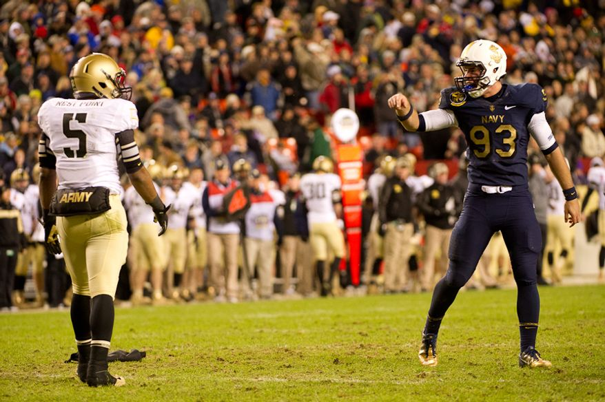 Army Black Knights linebacker Justin Trimble (5) gets yelled at by Navy Midshipmen defensive lineman Torri Preston (93) for a late hit at the end of the fourth quarter of the Army-Navy game at Fedex Field, Landover, MD, Saturday, December 10, 2011. (Andrew Harnik / The Washington Times)