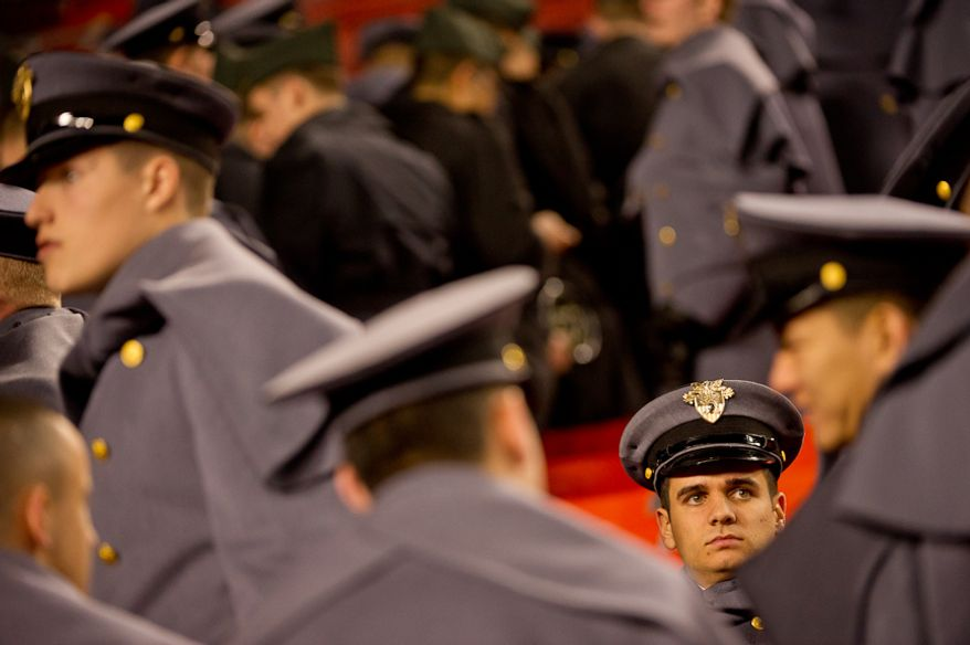 An Army cadet sits in the stand after the Army Black Nights are defeated by the Navy Midshipmen 27-21 at Fedex Field, Landover, MD, Saturday, December 10, 2011. (Andrew Harnik / The Washington Times)