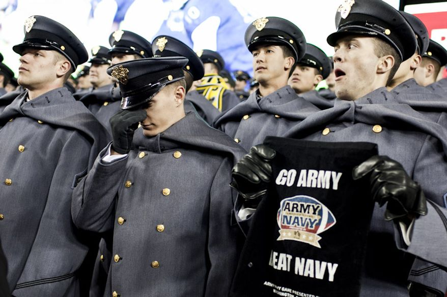 Army 1st Class Cadet John Paulson, at center, reacts to a play in the fourth quarter as Navy beats Army 27-21, for it's 10th win in a row, at FedEx Field in Landover, Md. on Dec. 10, 2011. (T.J. Kirkpatrick/ The Washington Times)