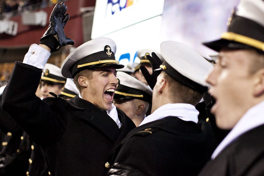 Midshipman 4th Class Blake Stout, at center, celebrates as Navy beats Army 27-21, for it's 10th win in a row., at FedEx Field in Landover, Md. on Dec. 10, 2011. (T.J. Kirkpatrick/ The Washington Times)