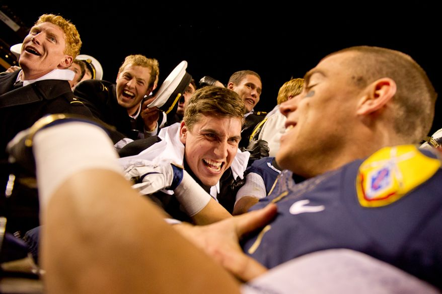Navy Midshipmen celebrate with Navy Midshipmen running back Mike Stukel (17) in the stands after defeating the Army Black Nights 27-21 at Fedex Field, Landover, MD, Saturday, December 10, 2011. (Andrew Harnik / The Washington Times)