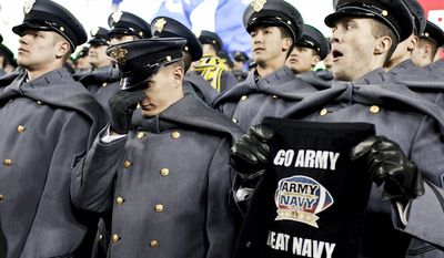 Army 1st Class Cadet John Paulson, at center, reacts to a play in the fourth quarter as Navy beats Army 27-21, for the 10th time in a row, at FedEx Field in Landover, Md. on Dec. 10, 2011.