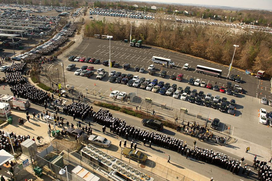 A long line of Navy Midshipmen march into the stadium before the start of the Army-Navy game at Fedex Field, Landover, MD, Saturday, December 10, 2011. (Andrew Harnik / The Washington Times)