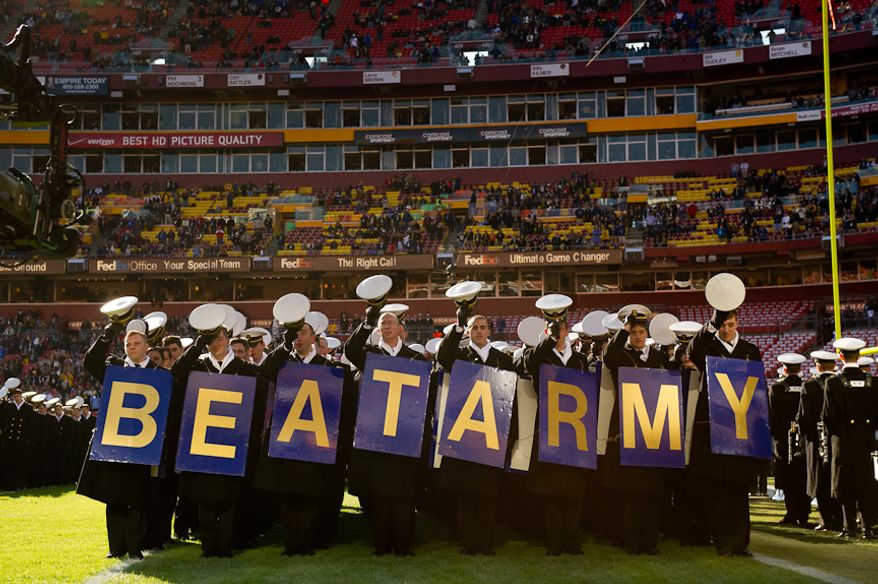 "Navy Midshipmen hold signs which read ""Beat Army"" as they march into the stadium before the Army-Navy game at Fedex Field, Landover, MD, Saturday, December 10, 2011. (Andrew Harnik / The Washington Times)"
