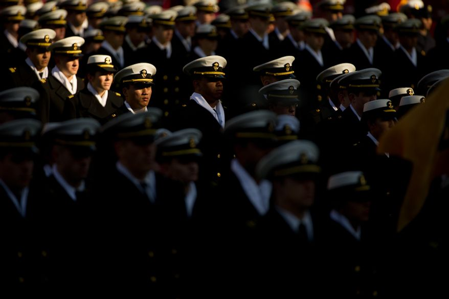 Navy Midshipmen march into the stadium before the Army-Navy game at FedEx Field, Landover, MD, Saturday, December 10, 2011. (Andrew Harnik / The Washington Times)