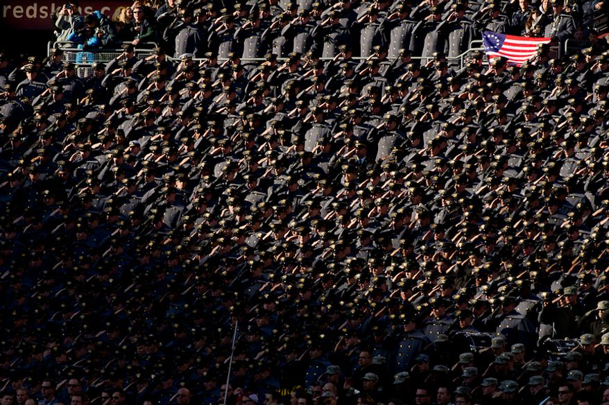Army Cadets salute in the stands before the Army-Navy game at Fedex Field, Landover, MD, Saturday, December 10, 2011. (Andrew Harnik / The Washington Times)