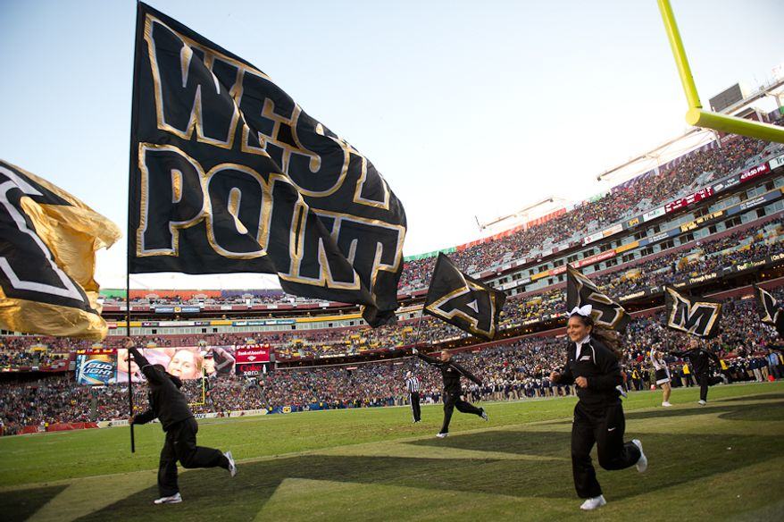 Cheerleaders celebrate after Army Black Knights running back Malcolm Brown (23) ties the game 14-14 just before halftime of the Army-Navy game at Fedex Field, Landover, MD, Saturday, December 10, 2011. (Andrew Harnik / The Washington Times)