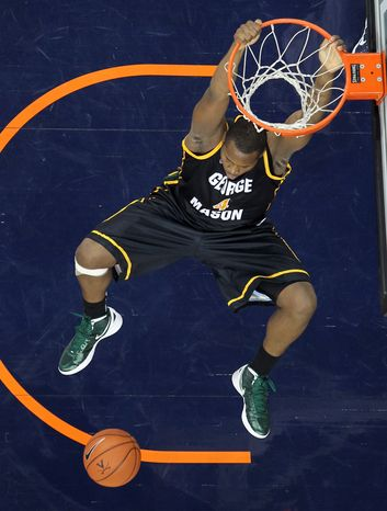 George Mason' Erik Copes dunks during the second half of an NCAA college basketball game against Virginia on Tuesday, Dec. 6, 2011, in Charlottesville, Va. Virginia won 68-48. Copes had six points and three blocks in GMU's 76-61 win over Radford on Saturday. (AP Photo/Andrew Shurtleff)