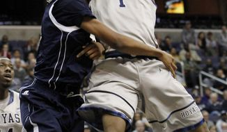 Georgetown forward Hollis Thompson goes to the basket against Howard center Oliver Ellison during the second half in Washington, Saturday, Dec. 10, 2011. Georgetown beat Howard 62-48 and Thompson had 12 points. (AP Photo/Ann Heisenfelt)