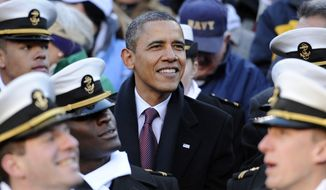 President Barack Obama looks on from the stands in the first half of the 112th edition of the annual Army vs. Navy NCAA college football game at FedEx Field in Landover, Md., Saturday, Dec. 10, 2011. (AP Photo/Nick Wass)