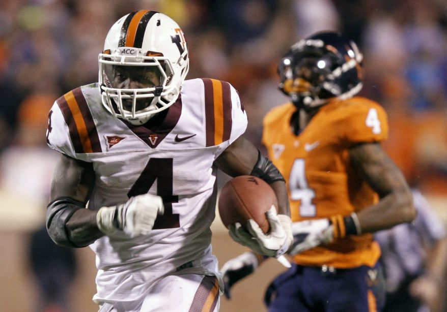 Virginia Tech running back David Wilson heads to the end zone as Virginia safety Rodney McLeod  chases during the second half at Scott Stadium in Charlottesville, Va., Saturday, Nov. 26, 2011. Virginia Tech won the game 38-0. (AP Photo/Steve Helber)