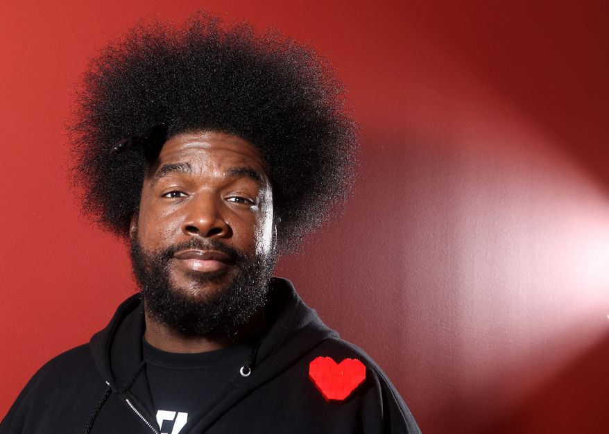 "Musician Questlove from the band The Roots, poses for a portrait, Thursday, Dec. 8, 2011 in New York. Questlove's band, The Roots, the house band for ""Late Night with Jimmy Fallon,"" must now run their song choices by NBC after the band performed an off-color song during an appearance by GOP Presidential candidate Michele Bachmann. (AP Photo/Carlo Allegri)"