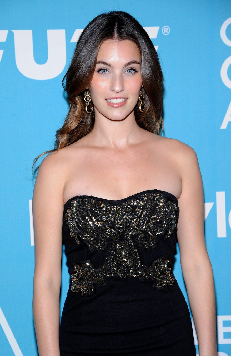 """Miss Golden Globe 2012, Rainey Qualley, attends """"A Night of Firsts"""" Golden Globe award season kick off party held in West Hollywood, Calif. on Thursday, Dec. 8, 2011. (AP Photo/Phil McCarten)"""