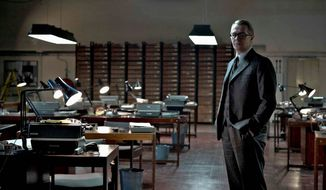 "Gary Oldman (right) spent a month mulling over whether to take on the role of George Smiley, which Alec Guinness put a distinctive stamp on. ""The ghost of Guinness just sort of loomed so large,"" said Mr. Oldman, shown on the set (above) during the filming of ""Tinker, Tailor, Soldier, Spy."" (Associated Press)"
