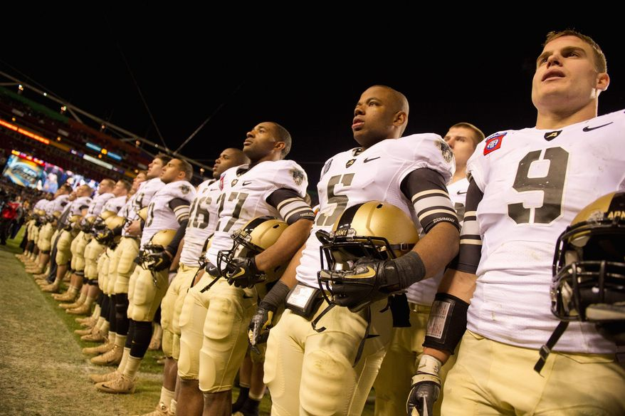 The Black Knights sing Army's alma mater after losing to Navy on Saturday at FedEx Field. It marked the first time in the 112-year series that the game was played inside the Capital Beltway. (Andrew Harnik/The Washington Times)