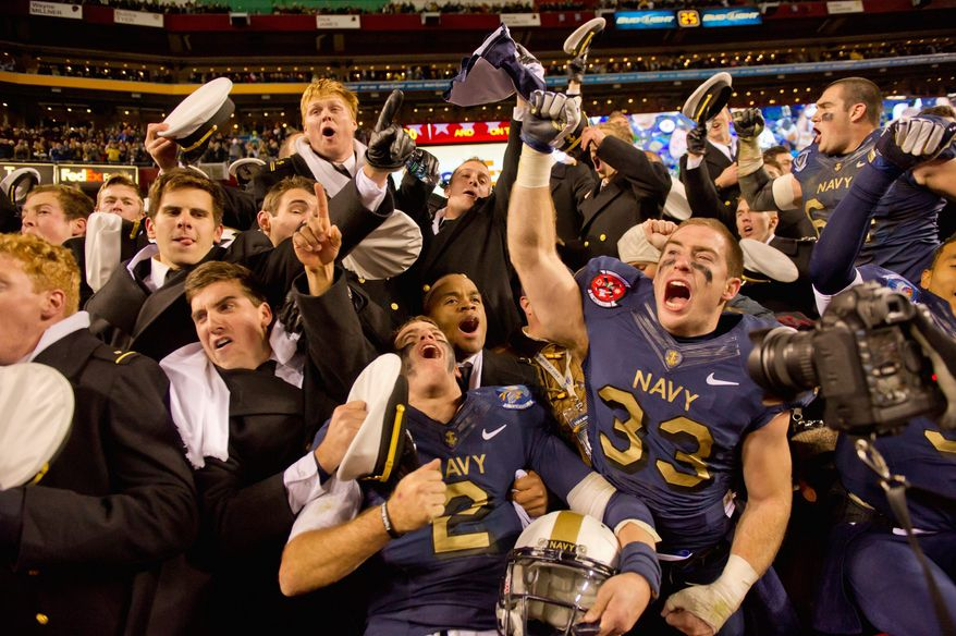 photographs by Andrew Harnik / The Washington Times Navy finished 5-7 and out of the bowl picture, but quarterback Kriss Proctor (2) and running back John Howell (33) still reveled in the Midshipmen's 10th straight win over Army. <b>ABOVE LEFT:</b> Navy's exuberance was evident before kickoff, as the Mids followed the flag onto the field. <b>BELOW RIGHT: </b>Fullback Alexander Teich's 10-yard touchdown run was his biggest play in his last game for Navy.