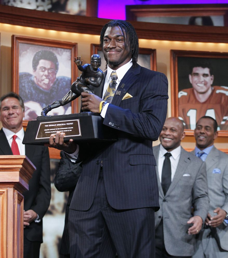 Robert Griffin III has said he will wait until after the Alamo Bowl on Dec. 29 to announce his plans. (Associated Press)
