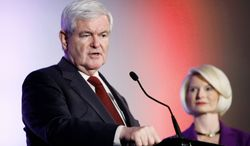Republican presidential hopeful Newt Gingrich addresses an Iowa veterans candidates forum Saturday in Des Moines, Iowa, as wife Callista looks on. Iowa's GOP presidential-preference caucuses on Jan. 3 are likely to be dominated by evangelicals, who are divided over whether to overlook or forgive Mr. Gingrich's personal history. (Associated Press)