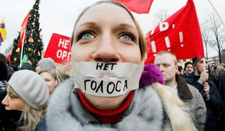 """A protester with the words """"no vote"""" covering her lips is one of more than 10,000 people at a St. Petersburg, Russia, rally Saturday after parliamentary elections that the throng claims were rigged to favor Prime Minister Vladimir Putin's Russia United party. (Associated Press)"""
