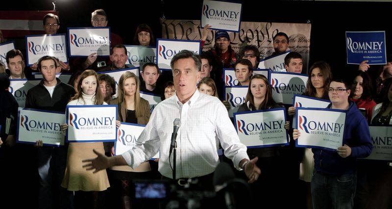 ON THE STUMP: Mitt Romney talks to reporters after the We the People Presidential Forum at a VFW Post in Hudson, N.H., on Sunday. The rise of challenger