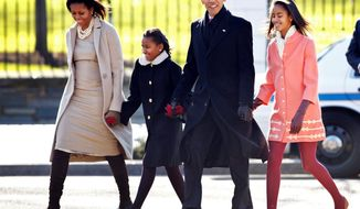 ** FILE ** In this December 2011 file photo, President Obama with first lady Michelle Obama and their daughters, Sasha and Malia, walk from the White House to attend a Sunday service at St. John's Church, where every president since James Madison has worshipped. (Associated Press)