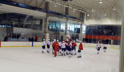 Troy Brouwer and the red team celebrate their scrimmage victory / Photo courtesy Joanne Pierce.