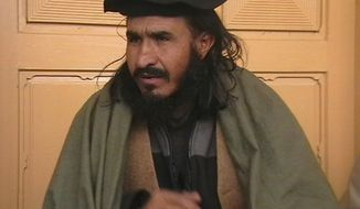 ** FILE ** Taliban commander Maulvi Faqir Mohammed, who is known to be deputy chief of the Pakistani Taliban, is seen in Pakistan's tribal area of Bajur in an undated photo. (AP Photo/Anwarullah Khan, File)