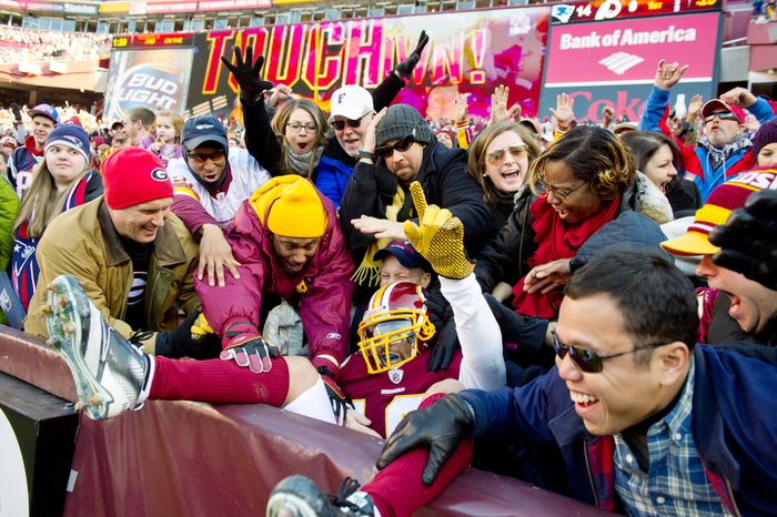 Washington Redskins wide receiver Jabar Gaffney (10) celebrates a 9 yard touchdown with fans in the first quarter. (Andrew Harnik / The Washington Times)