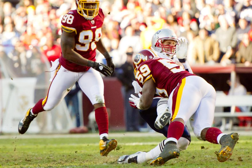 Washington Redskins inside linebacker London Fletcher (59) is called for unnecessary roughness for a hit against New England Patriots quarterback Tom Brady (12) as he runs for a 3 yard gain during the second quarter. (Andrew Harnik / The Washington Times)