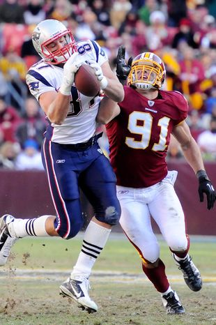 New England Patriots tight end Rob Gronkowski (87) hauls in a 37-yard touchdown reception in front of Washington Redskins outside linebacker Ryan Kerrigan (91) during third quarter action. (Preston Keres/Special to The Washington Times)