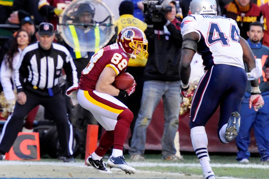 Washington Redskins wide receiver David Anderson (88) hauls in a 6-yard touchdown in the third quarter in front of New England Patriots strong safety James Ihedigbo (44). (Preston Keres/Special to The Washington Times)