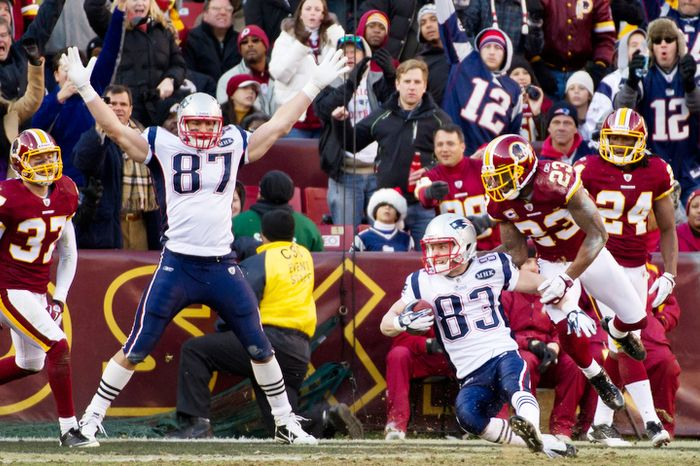 New England Patriots wide receiver Wes Welker (83) scores against Washington Redskins cornerback DeAngelo Hall (23) on a 23 yard touchdown pass to put the patriots up 34-27 in the 3rd quarter. (Andrew Harnik / The Washington Times)