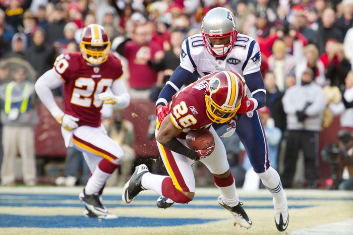 Washington Redskins cornerback Josh Wilson (26) intercepts a pass intended for New England Patriots wide receiver Tiquan Underwood (10) in the end zone in the 4th quarter. (Andrew Harnik / The Washington Times)