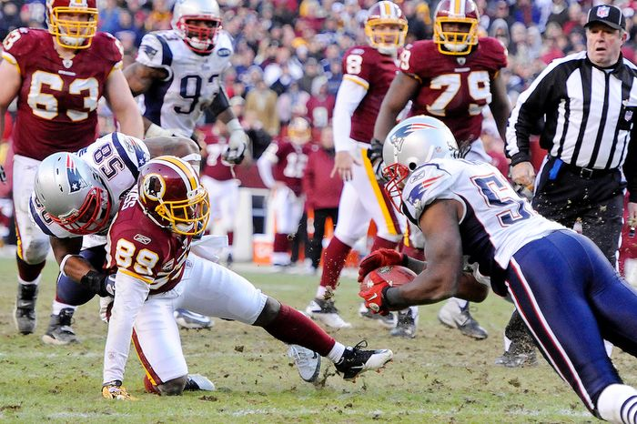 New England Patriots middle linebacker Jerod Mayo (51) intercepts a pass that bounced off Washington Redskins wide receiver Santana Moss (89) late in the fourth quarter to seal a Patriots victory. (Preston Keres/Special to The Washington Times)