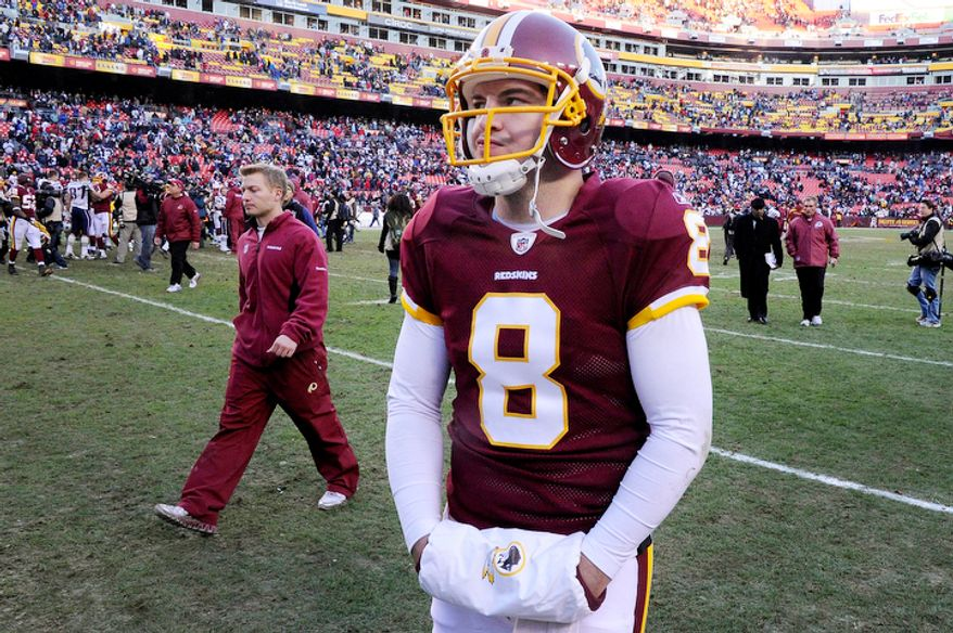Washington Redskins quarterback Rex Grossman (8) walks off the field after his interception late in the fourth quarter finished a 34-27 loss to the Patriots at FedEx Field in Landover, Md., on Sunday, December 11, 2011. (Preston Keres/Special to The Washington Times)