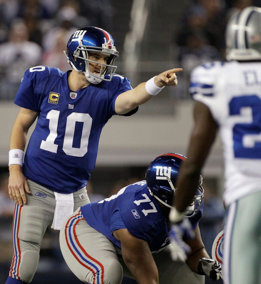 New York Giants quarterback Eli Manning threw for 400 yards and two touchdowns in Sunday night's omeback win over Dallas. (Associated Press)
