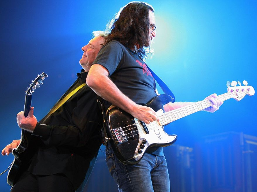 With its original members, Rush (left) is recording new music and packing huge venues around the world after nearly 40 years. Where you can't find the Canadian trio, however, is in the Rock and Roll Hall of Fame. (Associated Press)